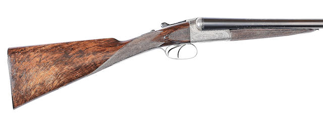 A 12-bore boxlock ejector gun by William Powell & Son, no. 10922 In its brass-mounted leather case