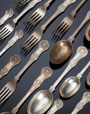 A Victorian silver Queen's pattern with honeysuckle heel part canteen of cutlery by George Adams, London 1870