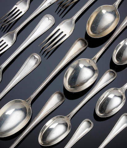 An Edwardian silver part canteen of bead edge cutlery for twelve settings by William Hutton and Sons, Sheffield 1904
