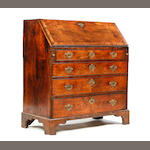 A walnut bureau, early 18th century and later