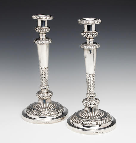 A George III silver pair of candlesticks by Matthew Boulton, Birmingham 1809/13, the sconces by Smith, Tate & Co. of Sheffield