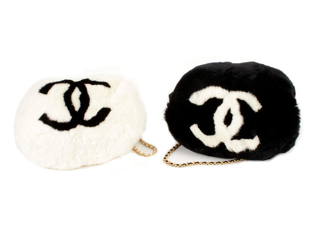Two Chanel monogrammed rabbit fur muffs