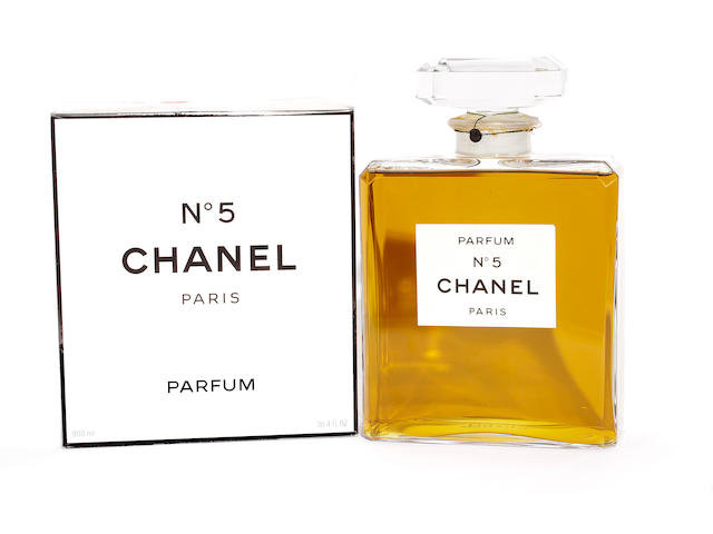 A large shop display size bottle of Chanel No 5 perfume, together with a 900ml bottle of Chanel No 5 perfume