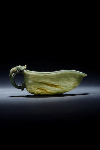 A pale green jade archaistic libation vessel Ming dynasty