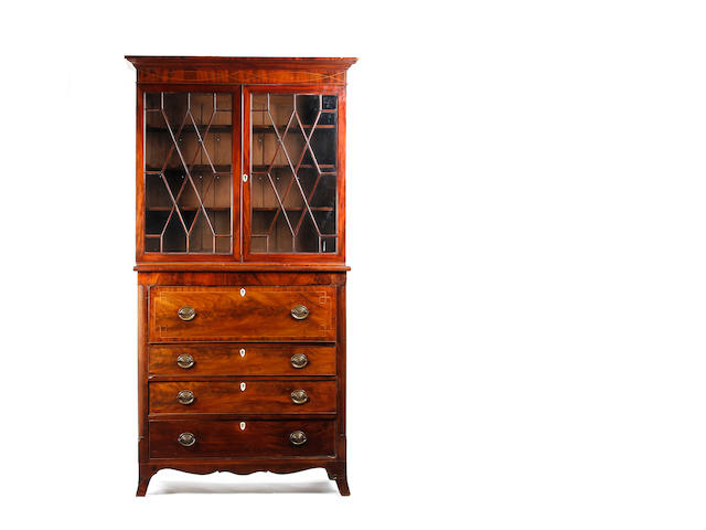 A late George III mahogany and inlaid secretaire bookcase