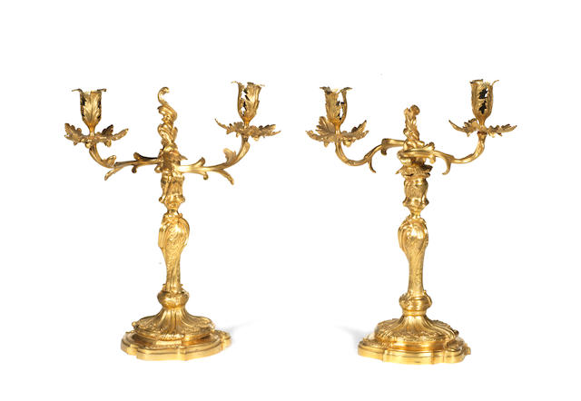 A pair of Louis XV and later ormolu candelabra