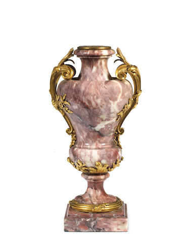 A French late 19th century ormolu-mounted Fleur de Pêcher marble urn