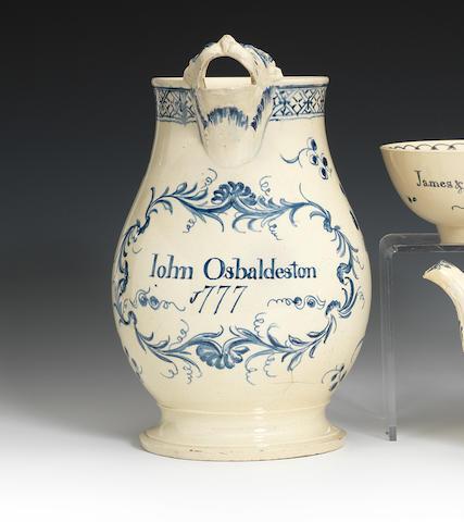 A large creamware mask jug, dated 1777