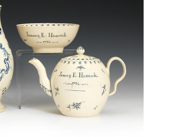 A Bovey Tracey teapot and cover and a matching bowl, dated 1784