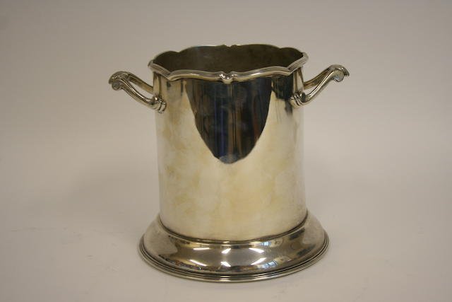 A silver two-handled bottle holder by Harrison Bros. & Howson,  Sheffield 1931