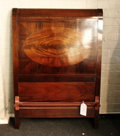 An early 20th century mahogany single 'sleigh' bed