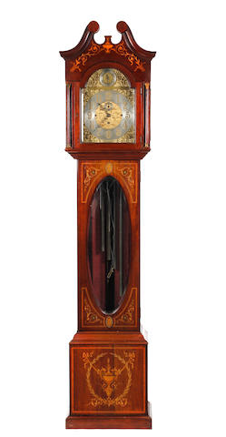 A fine Edwardian mahogany musical long case clock with vase and shell marquetry decoration and Westminster chime Anonymous