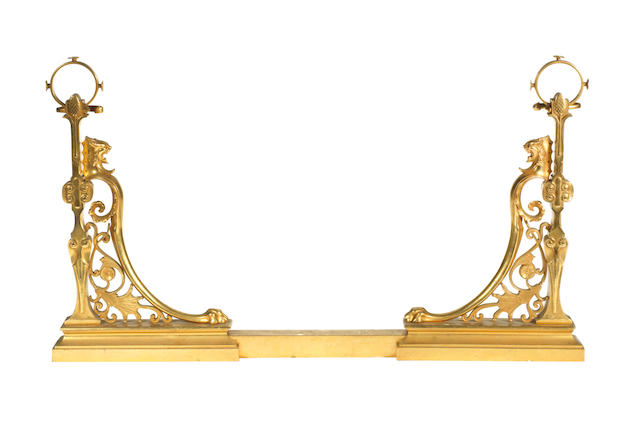 A French late 19th century Neo-Grec gilt-bronze adjustable fire-gate by Ferdinand Barbedienne, Paris