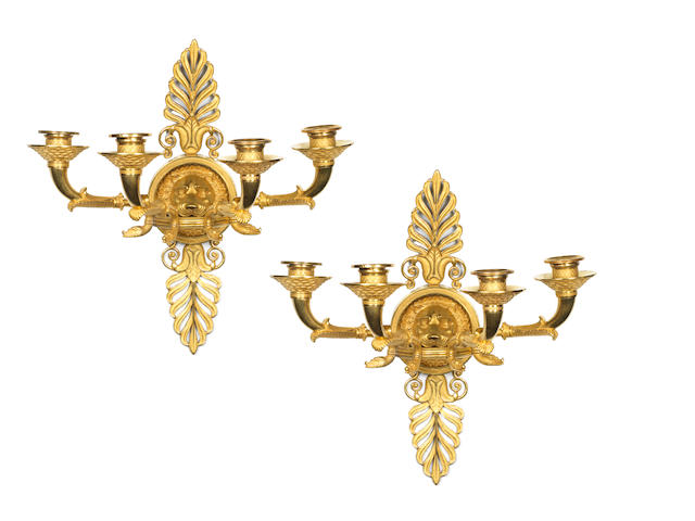 A pair of Empire wall-lights with lion's heads - regilt