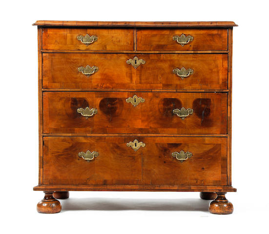 An early 18th century and later walnut chest of drawers