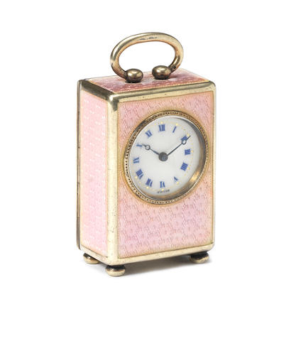 A good early 20th century silver and enamel decorated miniature boudoir timepiece  Hallmarked for CG CHECK THIS UP, London 1???