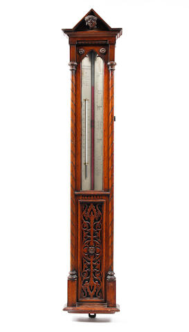 A 19th century oak cased long range wall barometer with thermometer in the Gothic style Negretti and Zambra