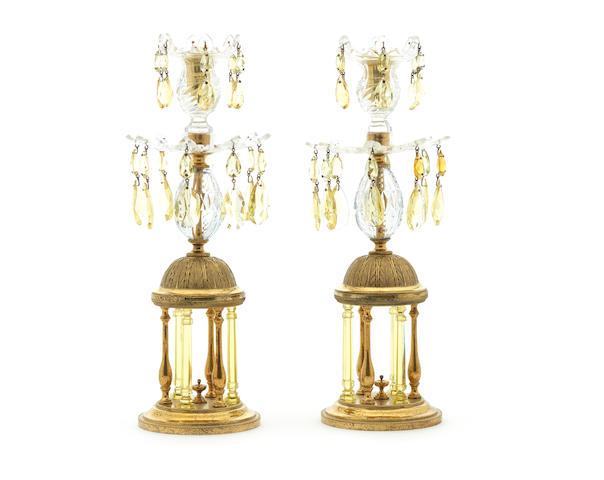 A pair of Regency gilt-brass and cut-glass luster candlesticks