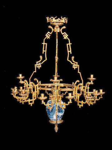 A French early 20th century gilt bronze and porcelain twenty-light chinoiserie chandelier
