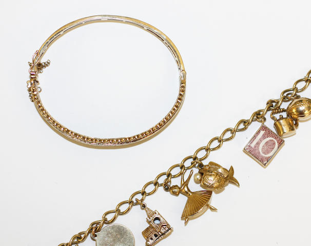 A charm bracelet and a hinged bangle,