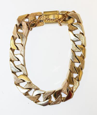 A flattened curb-link bracelet,