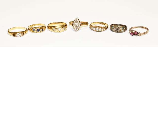A collection of seven rings,
