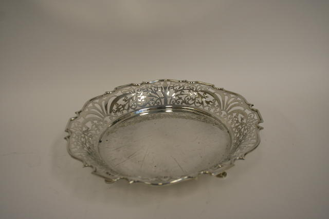 A silver circular pierced bowl by William Adams Ltd., Birmingham 1918