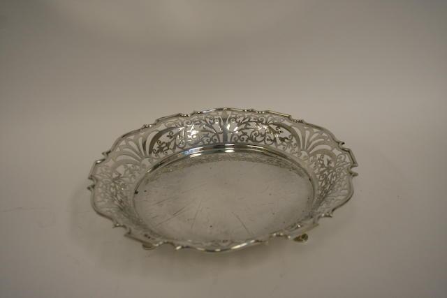 A silver circular pierced bowl by William Adams Ltd., Birmingham 1918