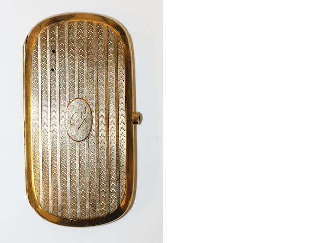 A yellow precious metal cigarette case,