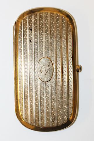 A yellow precious metal cigarette case,