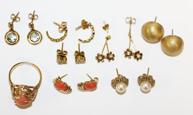 A collection of earrings and a ring,