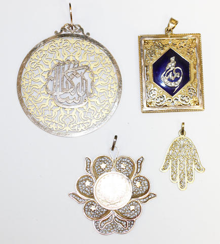 Three gold pendants and a giltmetal coin pendant,