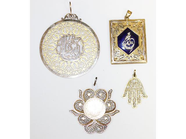 Three gold pendants and a giltmetal coin pendant,