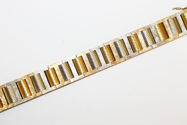 A two colour track-link bracelet,