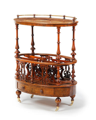 A late Victorian walnut and inlaid oval Canterbury whatnot