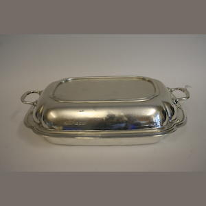 A silver two handled entree dish and cover by Sir John Bennett Ltd. London 1932