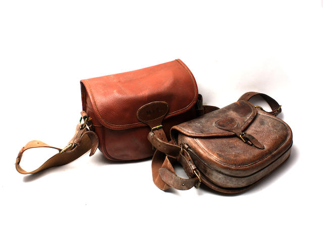 Two leather cartridge bags, initialled 'M. & S.' and 'C. E. S.', with canvas straps