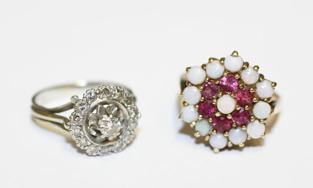 A diamond cluster ring, and a ruby and opal cluster ring,  (2)