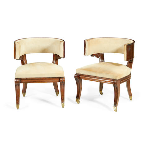 A pair of Regency mahogany tub back library chairs