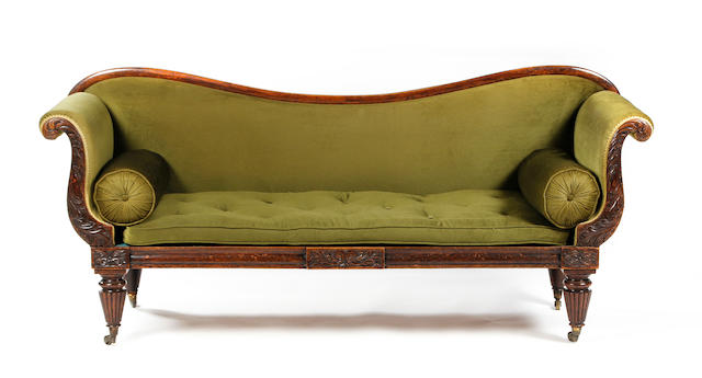 A George IV carved simulated rosewood scroll-ended settee