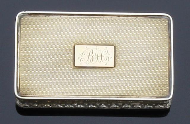 A William IV silver-gilt rectangular snuff box by Edwin Jones, Birmingham 1835