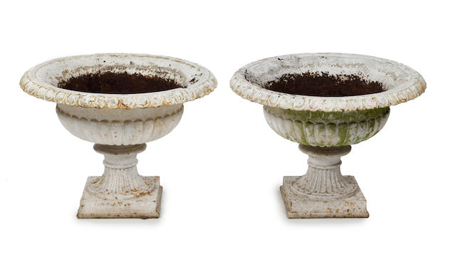 A pair of white-painted cast iron garden urns, 20th century