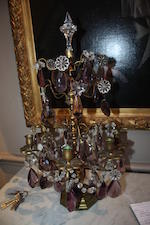 A pair of gilt metal colourless and amethyst glass table girandoles