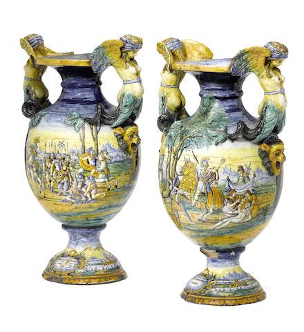 A large pair of Italian maiolica istoriato vases, circa 1860-80