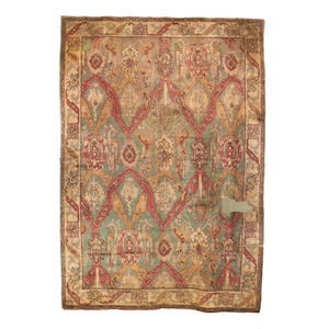 An Arts and Crafts design carpet, Donagal, 529cm x 376cm together with a smaller herth rug of similar design, 165cm x 101cm