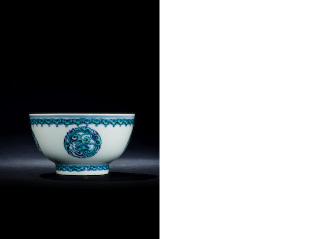 A rare doucai 'dragon' tea bowl Kangxi six-character mark and of the period