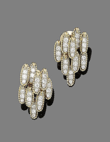 A pair of diamond-set earclips, by Van Cleef & Arpels