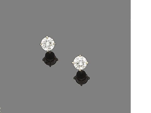 A pair of diamond earstuds, by Cartier