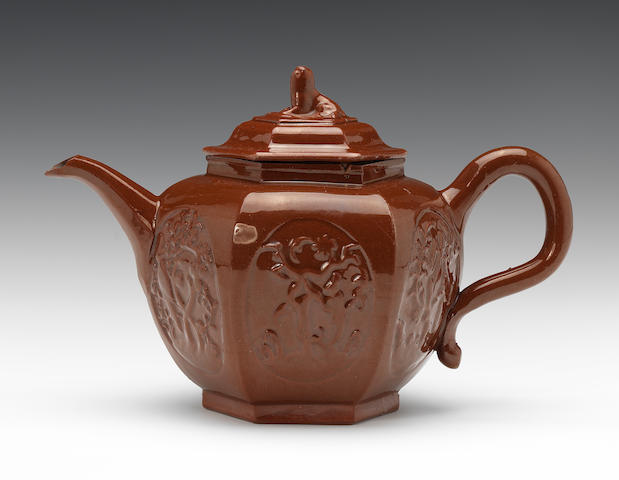 A Staffordshire glazed redware hexagonal teapot and cover, circa 1725-45