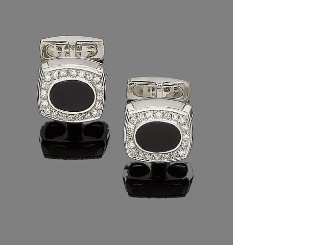 A pair of onyx and diamond cufflinks